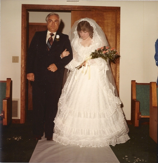 da da da da....almost there, bride escorted by her father, Lowell Tackett