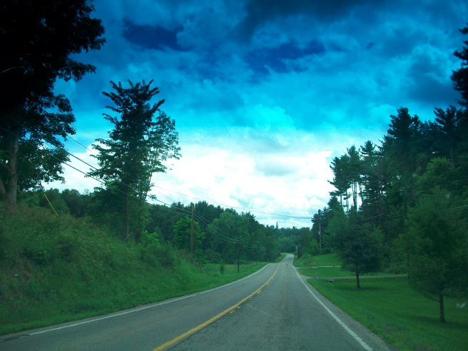 This was taken through the windshield of the car, which explains the hues in the top of the picture due to the tint on the windshield.  I thought it  made for a beautiful picture. I didn't think about how that would affect the picture, so it was a happy accident.