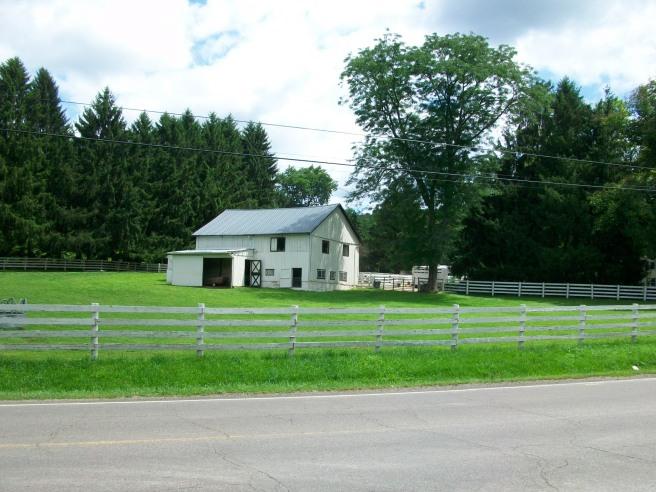 Barn on the corner where two roads met.