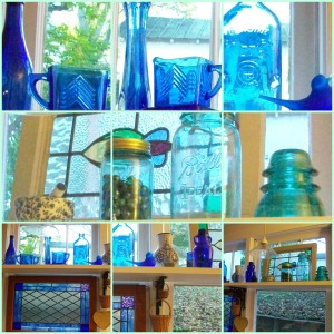 Blue glass vignette in the kitchen.  You will  notice the roof of my little dilapidated garage showing through the window behind the blue bottles.  The blue vintage sugar and creamer set was a gift from my cousin.  The windows were found at antique shops.  the white ceramic vase with blue flowers in the bottom, middle photo is from Slovakia and was a gift from my sister when she lived there.